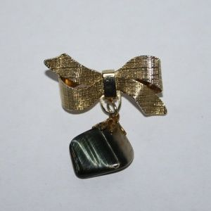 Beautiful gold bow brooch with dangling rock